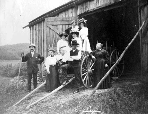 This posed photograph dating to about 1910 shows Maria Appleby with her father in the forefront surrounded by people presumed to be relatives.