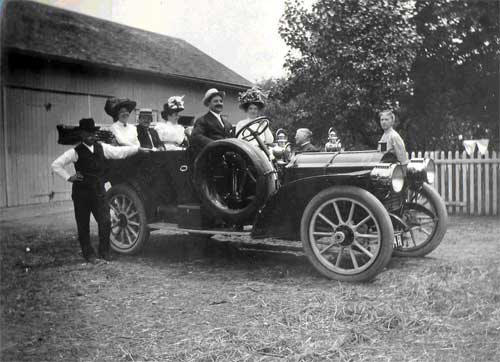 An early automobile in front of the barn circa 1915.