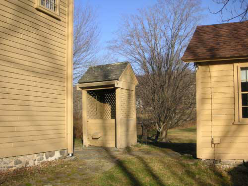 The well on the property sits conveniently between the old cook house and present-day kitchen.