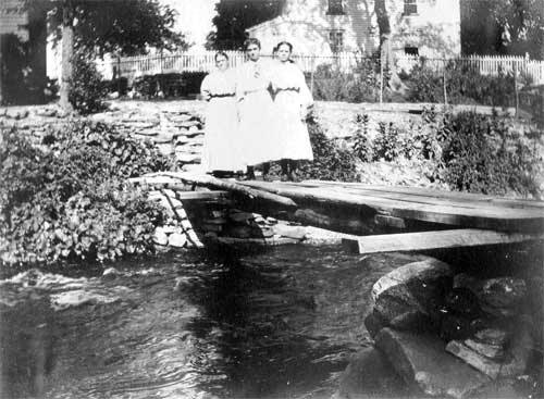 The bridge across the river that once ran behind the house, circa 1910.